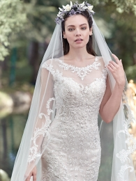 Elaborate patterned lace with tulle fit and flare wedding dress