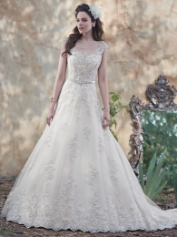 Glimmering lace appliqués wedding dress
